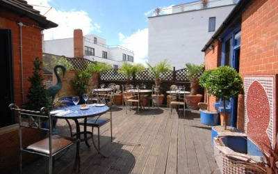 Paradise_by_Way_of_Kensal_Green_2009_._Paradise_Daytime_Sunny_Roof_Terrace.feature.000